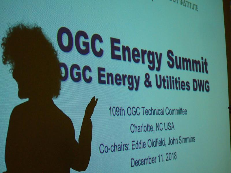 Eddie Oldfield silhouetted at the Second OGC Energy Summit